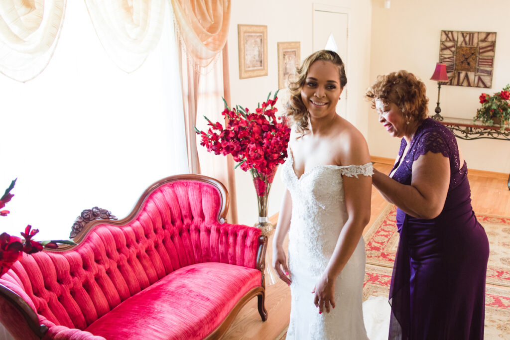 Putting on Dress in Bridal Cottage